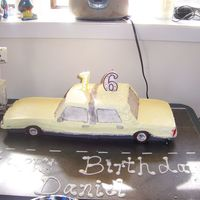 Dan's 16Th First attempt at 'carving' a cake. Was trying to copy a 1989 Ford Crown Victoria that we just purchased for 16yr ds to drive.......