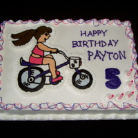 Purple Bicycle Cake This was for a little girl who wanted a b-day cake with a picture of her on her purple bike on the cake. The image is a BCT.