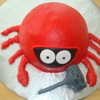 Crab Cake I used a wonder mold, and just carved the top off. I iced it in red frosting and smoothed it. Eyes are fondant. The mallet is a blow pop...