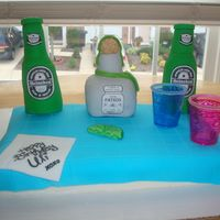 Patron & Heineken Cake Made the bottles out of rice krispy treats. Lime, napkin, and table cloth is made of fondant. Two plastic shot glasses. Images are printed...