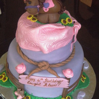 "Cowgirl 6"" and 9"" round from CC inspiration cakes. My daughter made the horse--:) Fun cake!!"