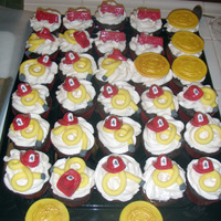 Fireman Cupcakes For a 4 year old aspiring fireman:) Choc mold for hats , trucks, and shields.
