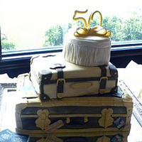 "50Th Anniversary Suitcase stack with steamer trunk with travel labels, old fashioned suitcase, and tufted hat box. Gumpaste ""50"". A really fun..."