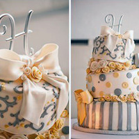 Topsy Turvy Wedding Cake In Buttery Yellow And Silvery Gray 7-10-13 rounds . Fondant roses with gumpaste/fondant bows. I used the triple leaf cutter for the scroll work on top. The silver strips,...