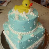 Duck And Bubbles  2-8 inch squares, chocolate devils food and 2-6 inch rounds, butter recipe yellow cake. buttercream icing over all. The duck is a bath toy...