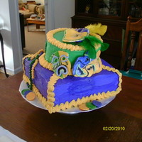 Mardi Gras Cake, Beads, Coins And Masks gum paste mask , beads,and coins buttercream icing.