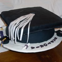 Graduation Hat Cake this was made for friends, who had a daughter,sister and son graduating.cake was made of fondant covering, everything is eatable.