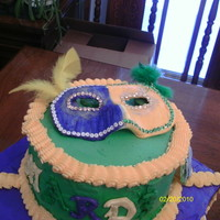 Mardi Gras Cake gumpaste mask, coins,and beads buttercream icing.