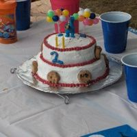 Small 2 Tier Cookie Monster   small 2 tier, each 2 layers with bc and reeses candy mixed in icing.