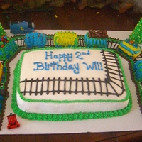 Train huge cake!! train tracks for train!! the train wrapped around the cake. it was too big and long to put ontop of the cake, so i thought...