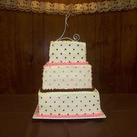 Pink & Brown Square Wedding cake with pink and brown dots/decorations.. all buttercream.