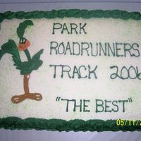 Track Cake This is a cake that I did for my son's track team party. Not an artist but I had to draw the roadrunner. My bct fell apart.