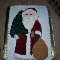 Old Country Santa This is a half sheet cake with a Wilton Old Country shaped pan on the top. This was a big hit at my husbands Christmas Party at work.