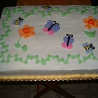Spring / Easter Cake   1/2 Sheet cake, I made this cake to match a plate given to me by my customer. I especially love the way the bees turned out.