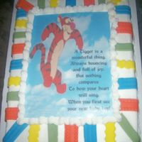 A Tigger Is A Wonderful Thing! 11x15 Sheetcake with buttercream, edible image, and fondant ribbons.