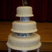 "Words To Love By This is a closeup picture of the cake. It is from the Wilton Tiered Cakes Book. It is a 6"",10"",14"" round covered in MMF and..."