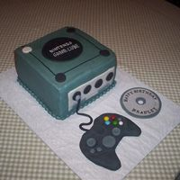 Game Cube  Cake is buttercream with fondant accents. The remote is actually an XBox remote. She changed her mind after it was made. My son actually...