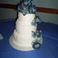 Blue Wedding Cake Pic   Not crazy about the flowers. The bride picked them out. They are silk. Becky