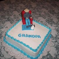 "Grandpa  I actually did this cake for my husband - it was for Grandparents day. The chair is plastic - the ""grandpa is made of fondant as well..."