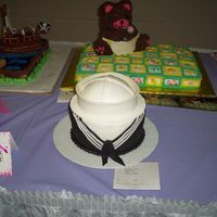 Navy Sailor I actually did this for a cake contest (local) and won 2nd place. The hat is a half ball. The brim if fondant. I had fun making it.