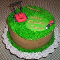 Lawncake2.jpg   I did this for a guy that is into lawnscaping. BeckyItems are made of fondant. Cake is buttercream.