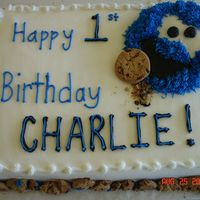 Cookie Monster Birthday  This is all done in buttercream frosting. Cookie monster's head is made from left over cake scraps. There are crushed cookies around...