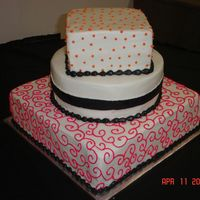 "Wedding Cake  3 Tier wedding cake. All done with buttercream frosting. The top tier is an 8"" square and has orange polka dots, the middle tier is a..."