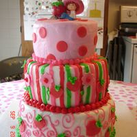 Strawberry Shortcake  This was for my daughter's 5th Birthday. It's done in buttercream frosting with fondant polka dots, hearts (strawberries), and...