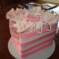 3D Victoria's Secret Bag this was for a close friend's bridal shower. buttercream cake with fondant stripes and fondant tissue paper. would do all fondant if i...