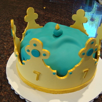 "Golden Birthday Crown Cake this was for a little girl's golden birthday. she wanted a golden crown with aqua accents. the cake is an 8"" cake covered in aqua..."