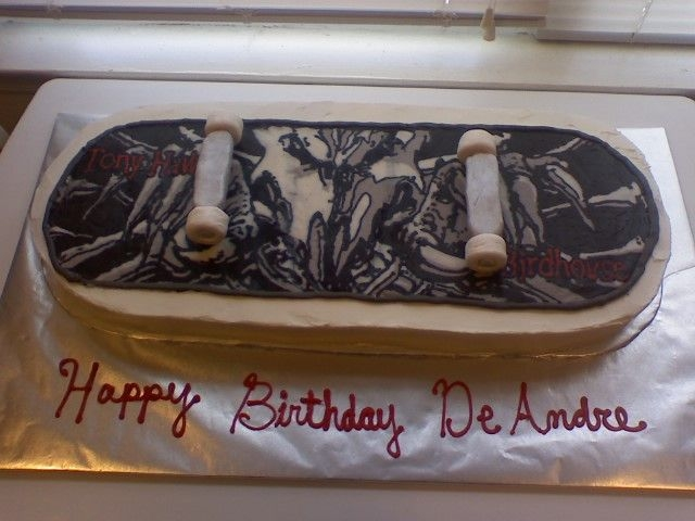 Skateboard Cake Customer wanted a skateboard for her son. White cake, buttercream, Frozen buttercream transfer. Wheels made of fondant.. Looked Great!