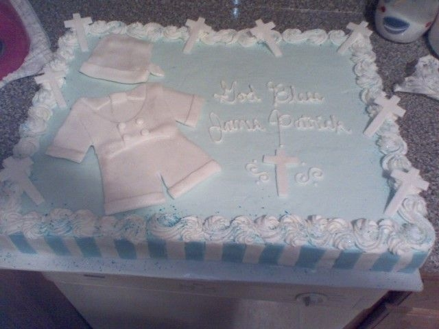 Blue Christening For Baby Boy Done in buttercream with fondant decorations.
