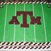 Texas A&m Football Cake   This cake was made for a football kickoff party. It's white chocolate decorated with buttercream icing.