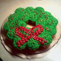 Wreath Cupcake Cake  Cupcakes shaped like a wreath and the iced. Decorated with sprinkles and mm's. This would be a lot of fun to do with childrenI really...