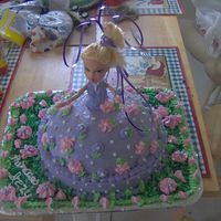 Princess Cake This is a homemade yellow cake with homemade buttercream icing. It was done for a girl I babysit for her 8th birthday. This is the first...