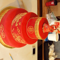 Chinese Wedding Cake This cake was done in the traditional Red and Gold. I followed the brides exact specifications. Its hard to tell, but on the sides of the...