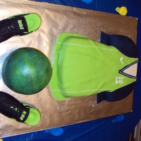 Soccer This was for my daughters birthday. The shoes are RKT (Rice Krispy Treats) covered in fondant. The ball is 1/2 RKT and 1/2 cake.