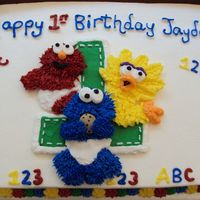 Sesame Street 1St Birthday This was for a friends son. Got many ideas from CC and web to make a simple sheet cake. Also inpictures is the Smash Cake TFL.
