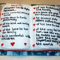 Book Of Love  All BC. Chocolate chocolate chip cake. My favorite part of this cake was the board underneath. Those are pics of the bride and groom turned...