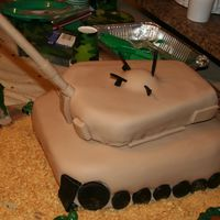 "Army Tank Birthday Cake The bottom cake is three 1 1/2"" layers and the top is two 2"" layers. All covered in fondant with gumpaste wheels and decorations..."