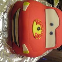 Lightning Mcqueen This cake was done for a birthday boy who loves cars! All cake carved and then topped with fondant. All decorations are fondant also.