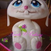 "Littlest Pet Shop Bunny 3-D bunny made from the WIlton wondermold pan and a 10"" and 6"" oval for the head. Iced with traditional buttercream and covered..."