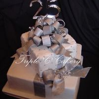 "25Th Anniversary Packages 10 & 6"" WASC cakes iced with vanilla IMBC and covered in fondant. All bows handmade from gumpaste, painted with real silver dust..."