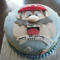004.jpg Super Mario done in marshmellow fondant on a 10 in round cake