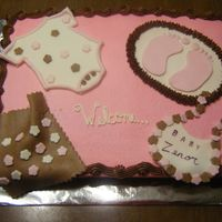 Pink And Brown Baby Shoer buttercream icing with mmf fondant accents pink and brown were the colors