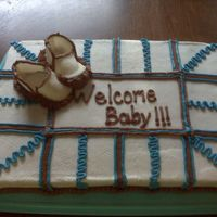 Brown And Blue Baby Booties just a cake with brown and blue my first time doing fondant baby booties