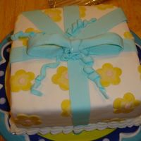 Course Iii Package Cake Made this in class yesterday. I'm not crazy about my bow. The flowers look more mustardy in the picture than they really were. Thanks...