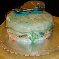 Fishing A likeness of hubby in his boat. Orange cake with cream cheese icing, cream cheese and mandarin orange filling.