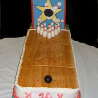 "Bowling Alley Cake 2 9x 13, end to end. One french vanilla, one strawberry. Buttercream icing. Fondant ""alley"" and sign. Fondant pins wrapped around..."