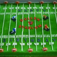 Football Field This is a sheet cake frosted in buttercream with fondant accents. The name of the stadium is named after the birthday boy